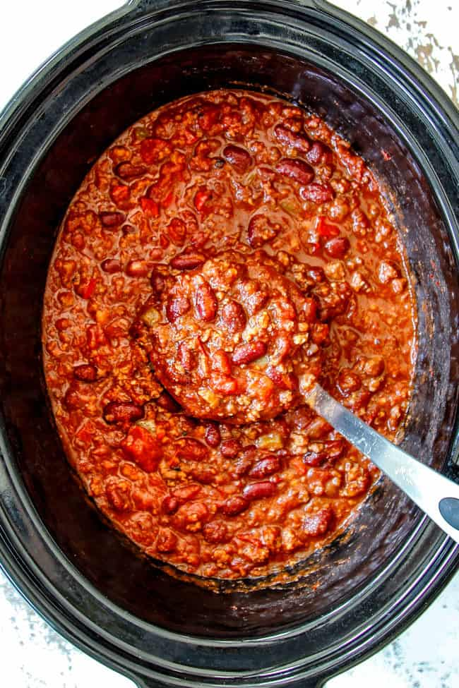 top view of a ladle scooping up best crockpot chili recipe winner