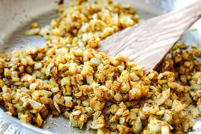 showing how to make pineapple fried rice recipe by cooking onions with curry powdr