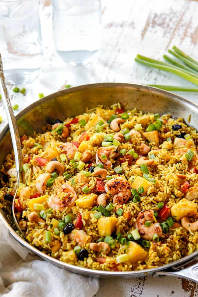 showing how to serve pineapple fried rice from a skillet