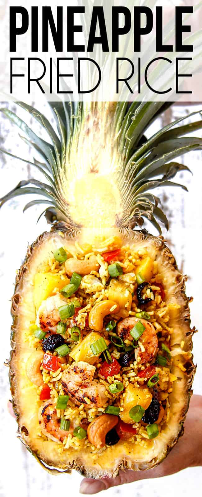 top view of pineapple fried rice in a hollowed out pineapple bowl