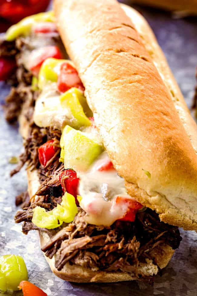 up close of crock pot Italian Beef Sandwich recipe laying on a tin