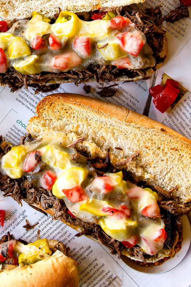 up close of slow cooker Italian Beef Sandwich recipe loaded with toppings
