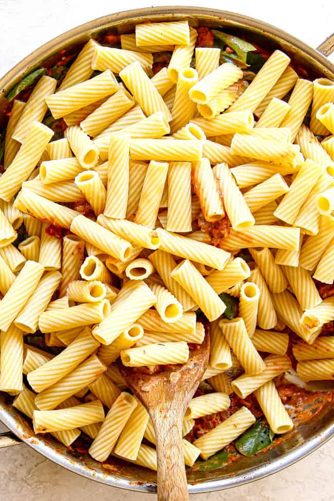 showing how to make rigatoni recipe by adding rigatoni