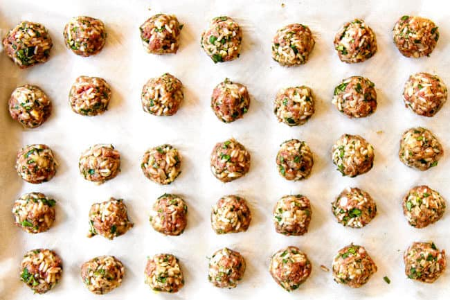 showing how to make meatballs for Albondigas Soup by forming meatballs and placing them on a baking sheet