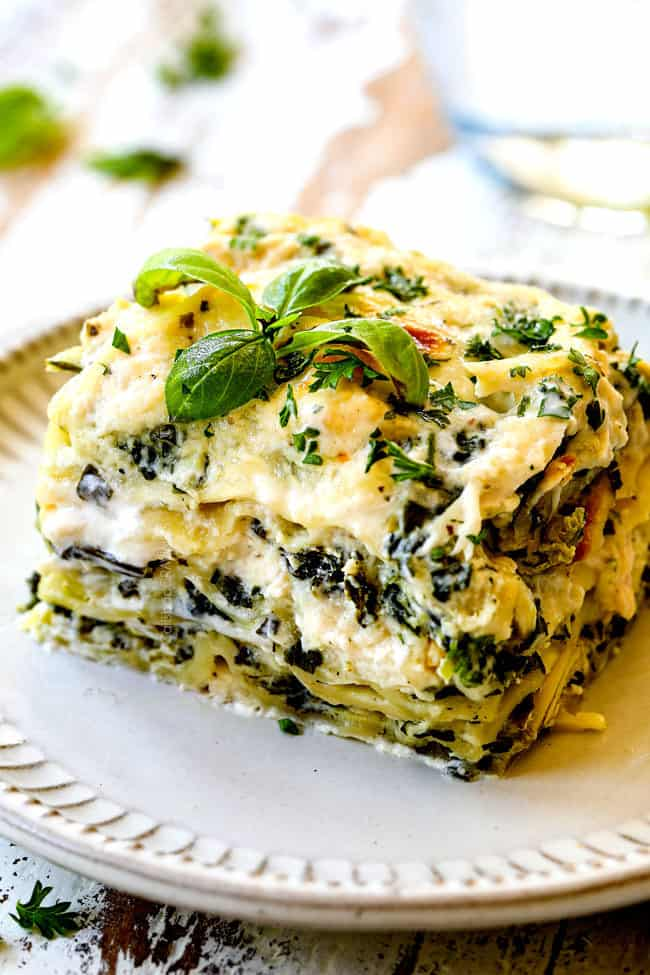 up close of a slice of chicken lasagna with spinach and artichokes