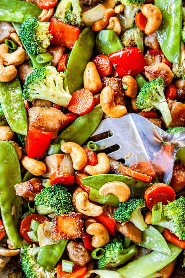 up close of stirring stir fry sauce into chicken and broccoli stir fry recipe