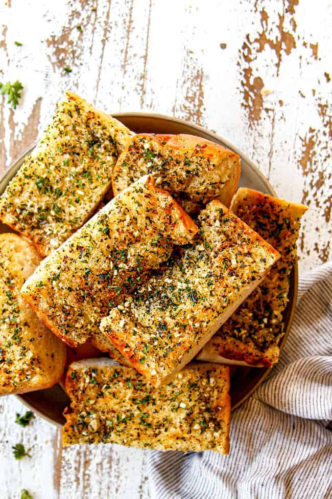 a bowl of garlic bread in oven