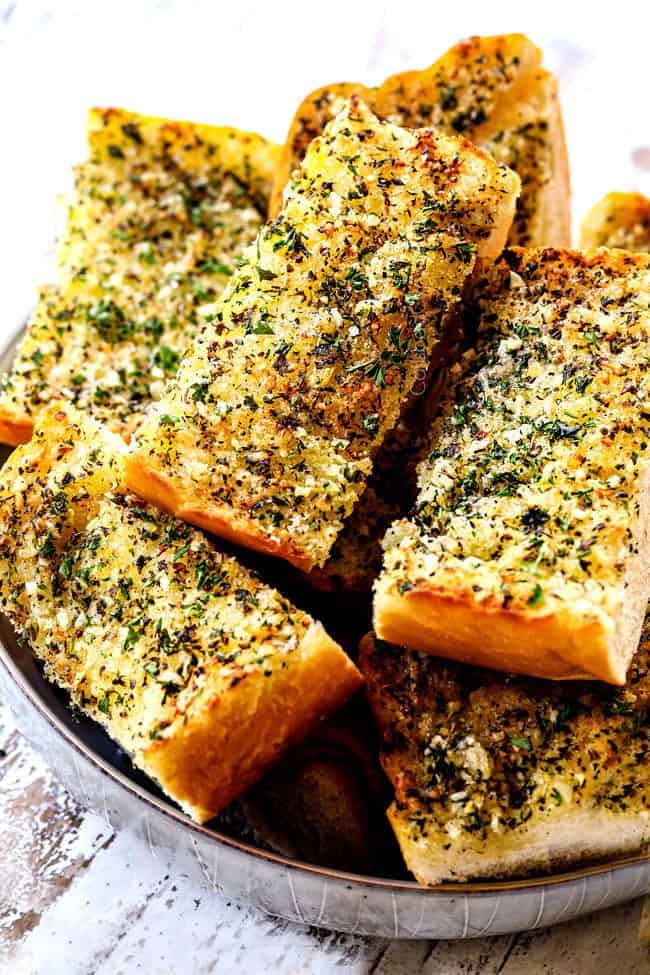 slices of best garlic bread recipe in a bowl