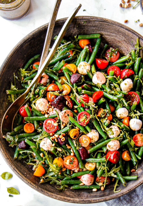 top view of green bean and tomato salad in a wood bowl