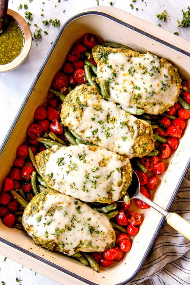 showing how to make pesto chicken bake recipe by letting chicken rest before slicing