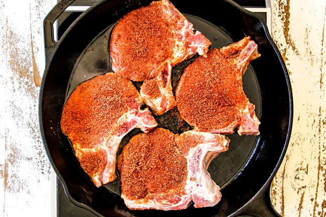 showing how to make pork chops with apples by seasoning pork with a dry rub