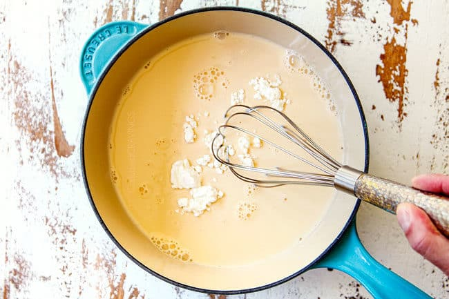 showing how to make queso blanco by whisking cornstarch into evaporated milk