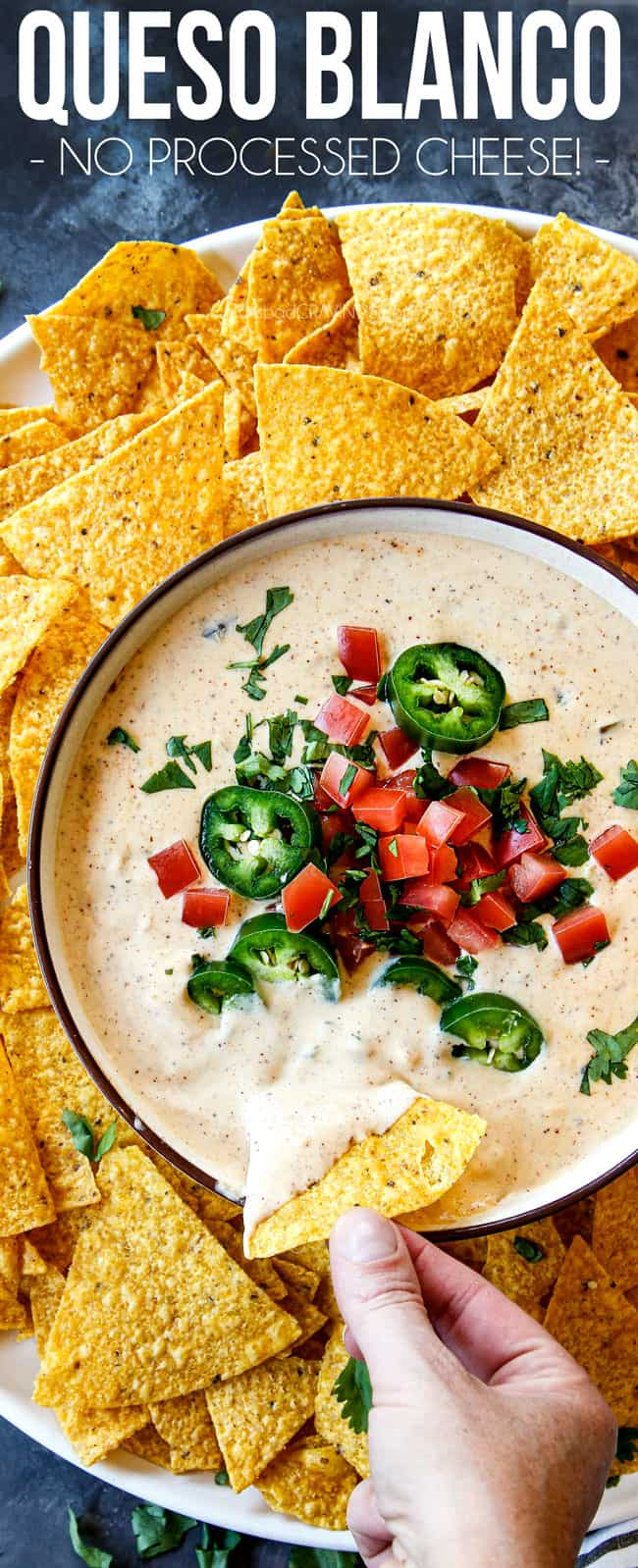 showing how to serve queso blanco by dipping chips into dip