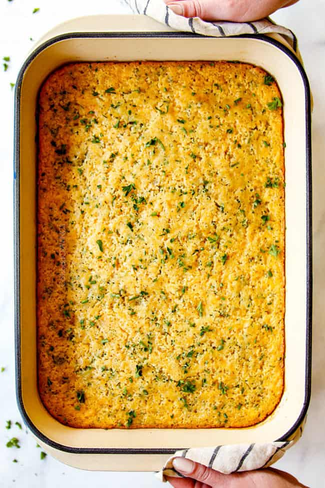 top view of sweet corn casserole recipe in a baking dish