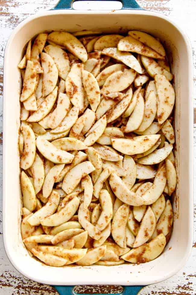 showing how to make easy apple crisp recipe by layering sliced apples in 9x13 pan