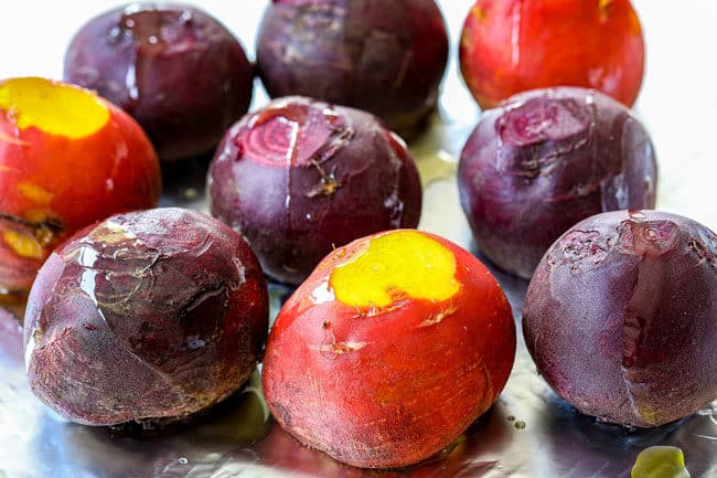 showing how to make beet salad by roasting beets in foil drizzled with olive oil