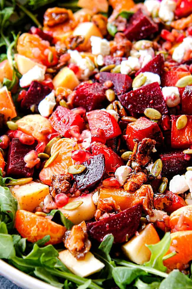up close of roasted beet salad with roasted beets, oranges, walnuts, pomegranate and goat cheese