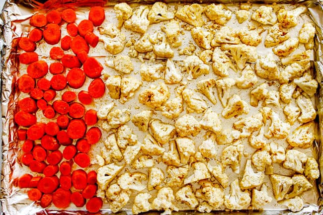 showing how to make cauliflower salad by spreading them on a baking sheet to roast
