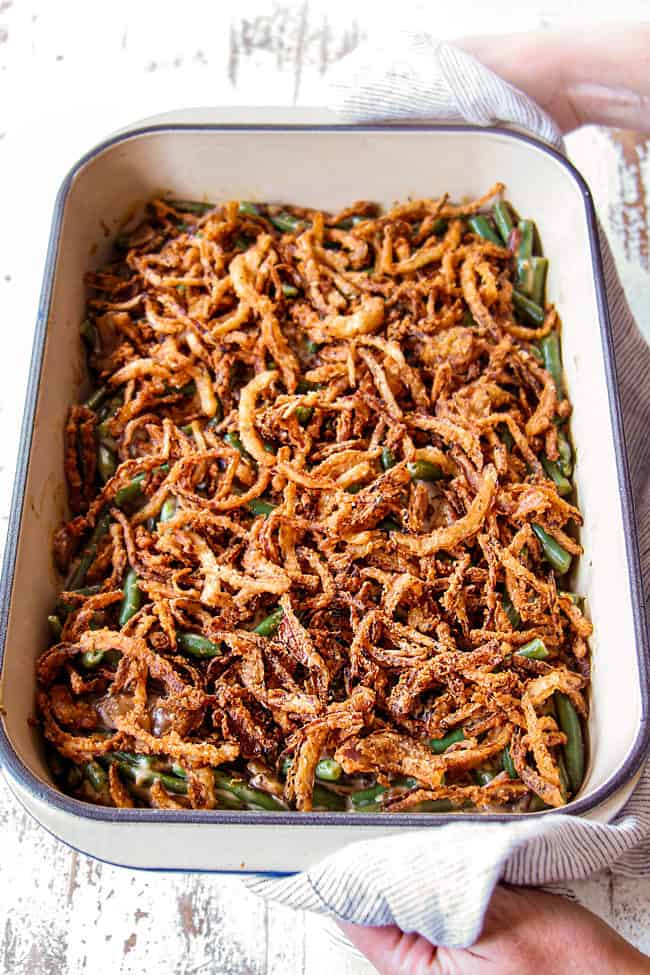 showing how to make fresh green bean casserole by baking until hot and bubbly