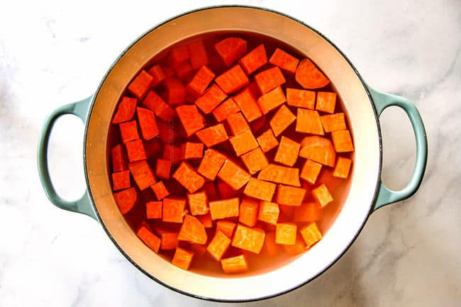 showing how to make mashed sweet potatoes by adding peeled, cubed sweet potatoes to a pot with water