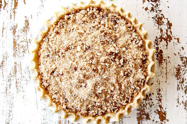 showing how to make Pear Pie by adding crumble topping
