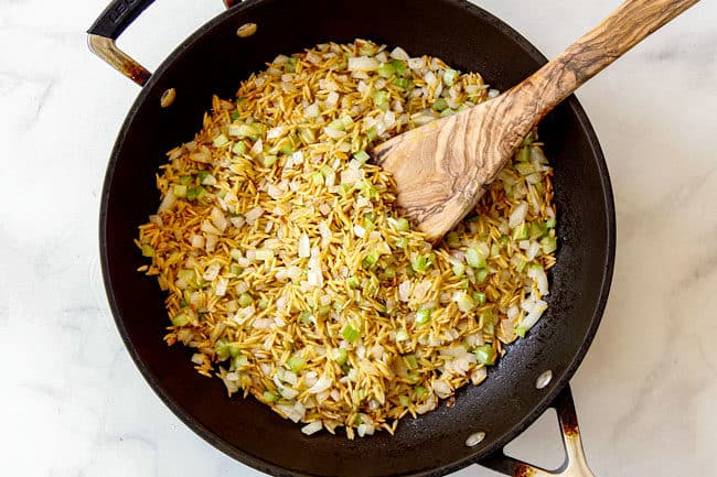 showing how to make rice pilaf by toasting orzo with onions