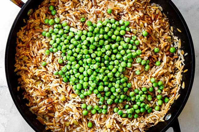 showing how to make rice pilaf by adding peas and letting pilaf rest
