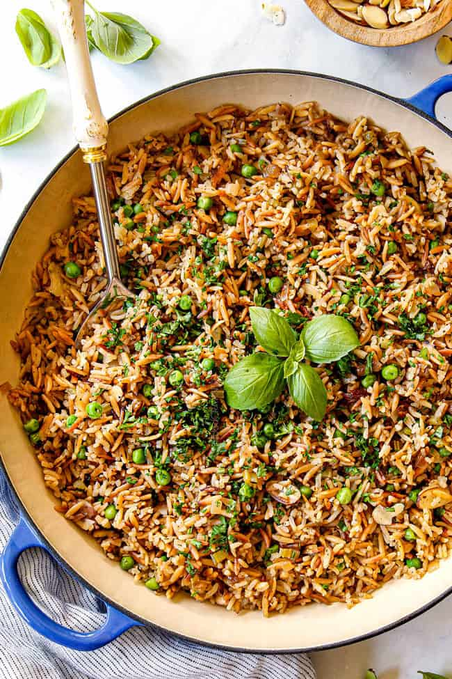 showing how to make rice pilaf with orzo by garnishing with fresh parsley