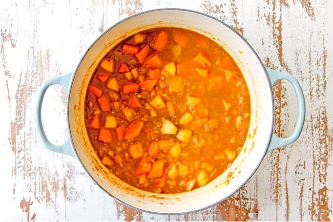 showing how to make butternut squash soup recipe by simmering with chicken broth