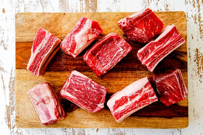 showing what short ribs look like by placing on a cutting board