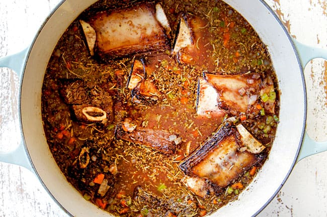 showing how to make short ribs by adding beef broth, pomegranate juice and seasonings