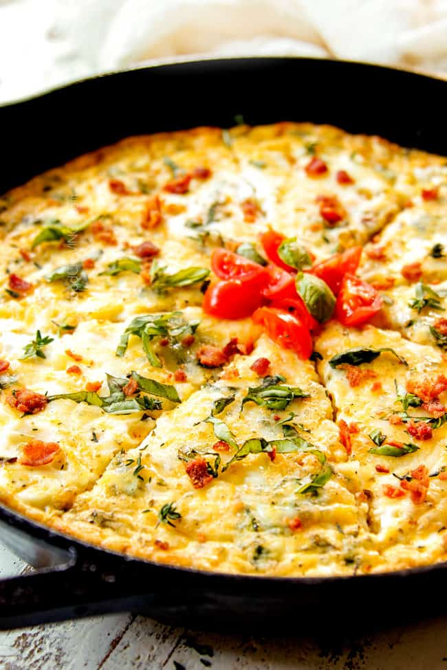 up close of a slice of easy egg frittata with bacon, broccoli, tomatoes and cheese