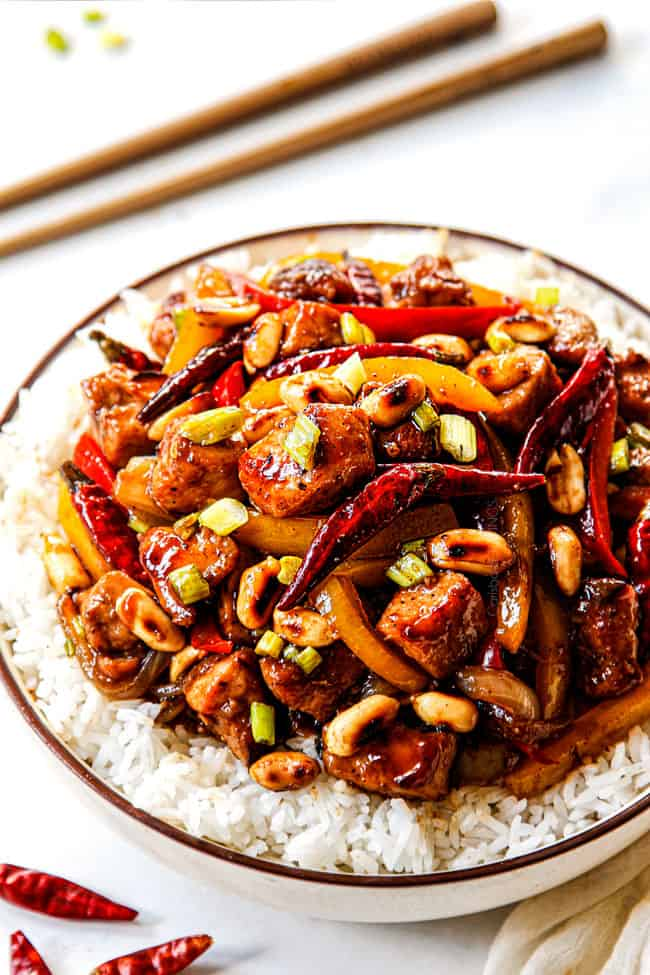 showing how to customize the heat of Szechuan chicken by adding Thai chili seeds