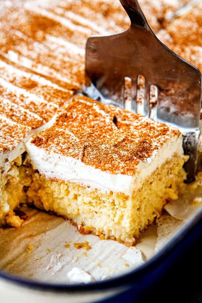 showing how to serve authentic tres leches cake by removing from pan with a spatula