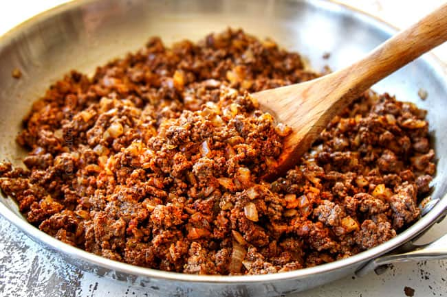 showing how to make ground beef tacos by browning beef with onions and taco seasonings