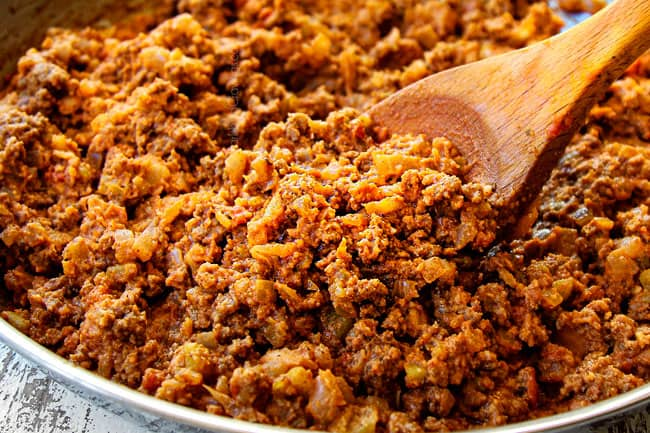 showing how to taco meat by cooking ground beef with seasonings, salsa and green chilies