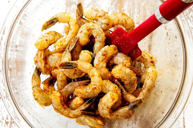 showing how to make Cajun shrimp pasta by marinating shrimp with olive oil, lime juice and Cajun seasoning
