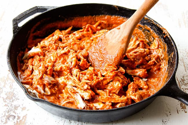 showing how to make Tostadas de Tinga by stirring chicken into chipotle sauce before adding to tostada shells