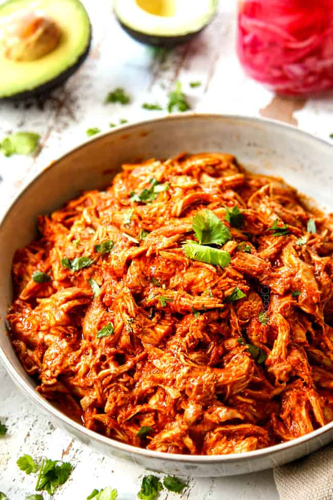 up close of slow cooker chicken tinga recipe in a bowl garnished with cilantro