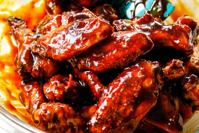 showing how to make Korean Chicken Wings by coating with Korean BBQ Sauce with gochujang