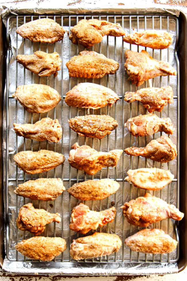 showing how  to make Korean Chicken Wings by  lining wings on a baking sheet to bake in the oven