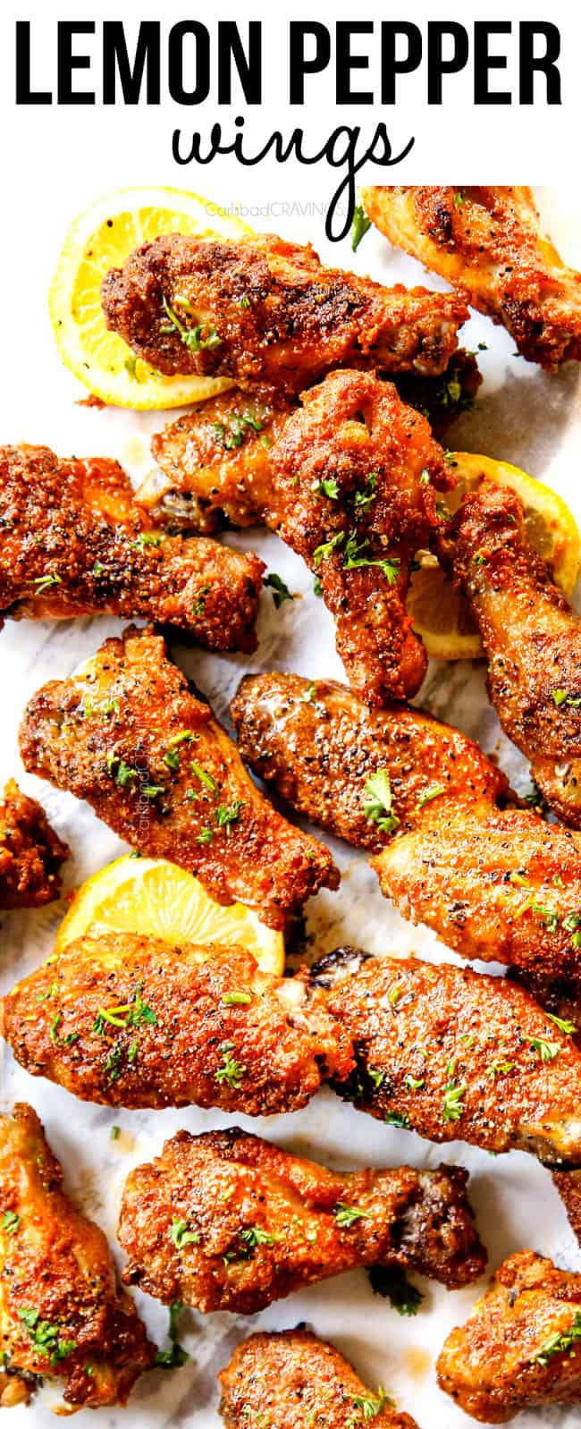 top view of lemon pepper wings serving with lemon pepper wings sauce