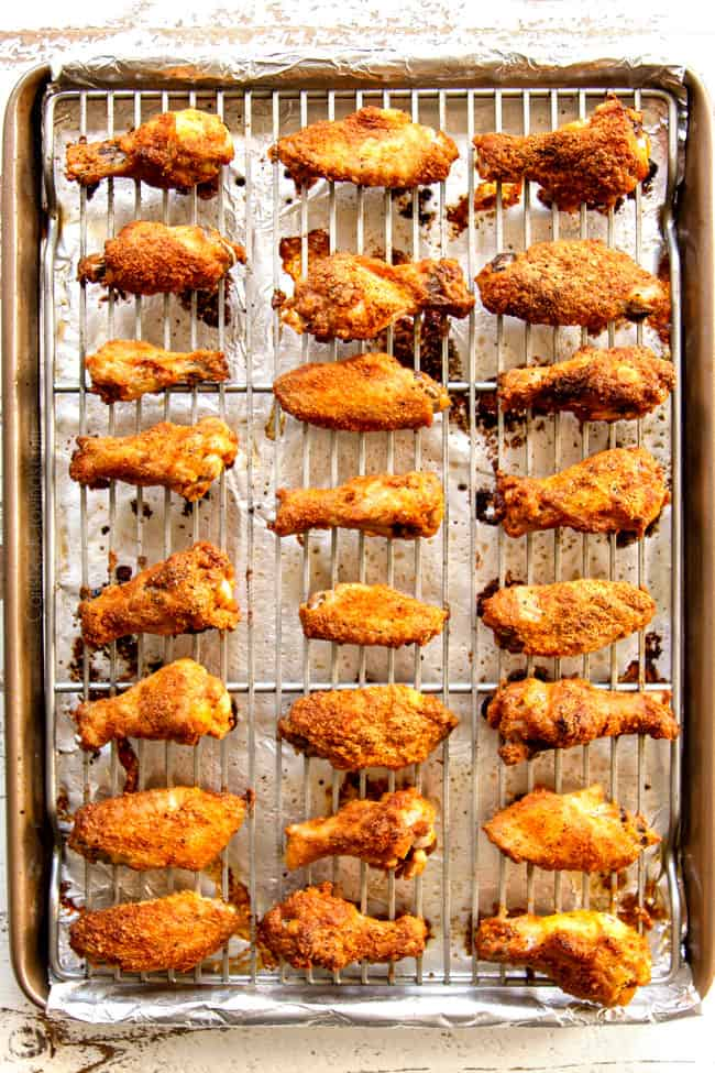showing how to make lemon pepper chicken wings by baking wings until crispy