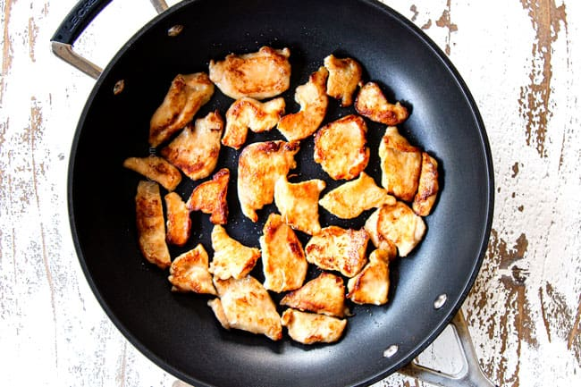showing how to make Moo Goo Gai Pan by searing thinly sliced chicken on both sides in a skillet