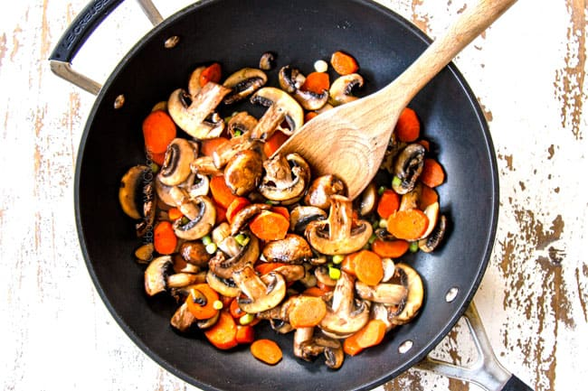 showing how to make Moo Goo Gai Pan by stir frying mushrooms and carrots