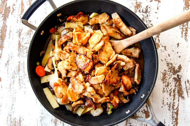 showing how to make Moo Goo Gai Pan by adding seared chicken back to pan