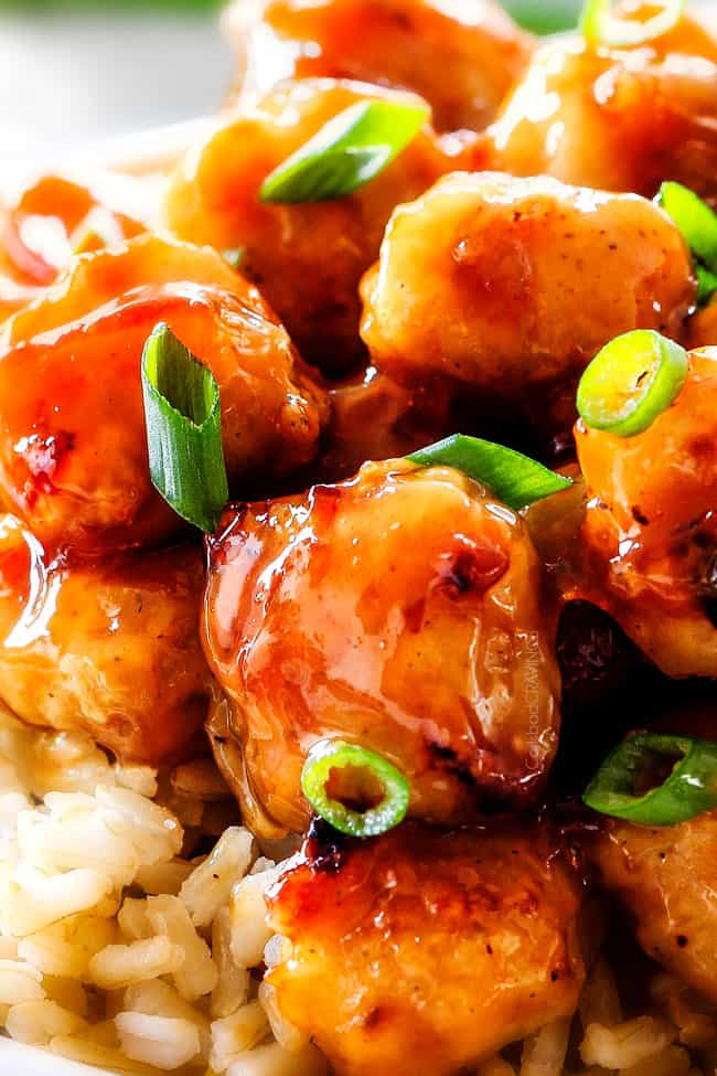up close of showing the breading of orange chicken