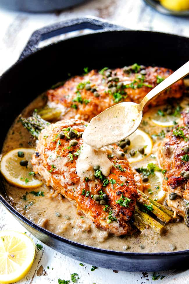 showing how to make Chicken Piccata by drizzling lemon sauce on top of a chicken breast in the skillet