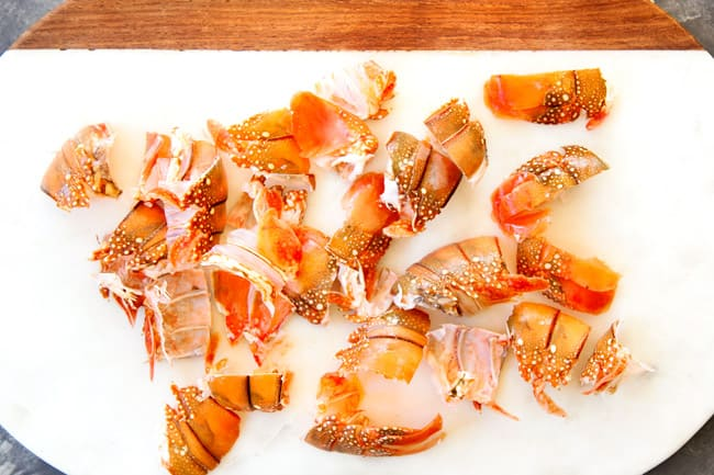 showing how to make lobster bisque by cutting lobster tails into pieces