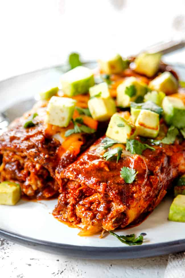 up close of chicken enchilada recipe showing how saucy it is